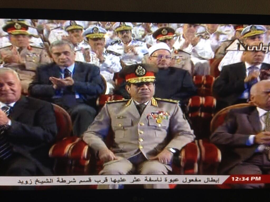 Egypt Sisi on State TV, to his left is the PM