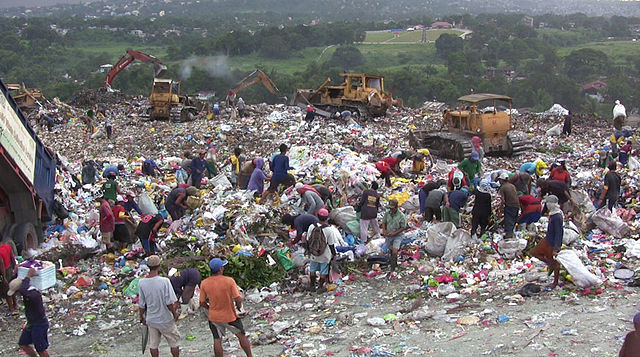 People in garbage dump