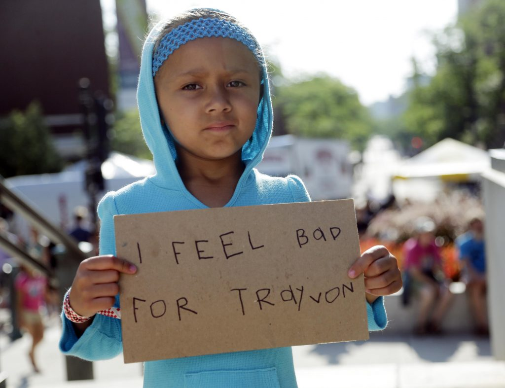 Trayvon child with I feel bad for Trayvon sign