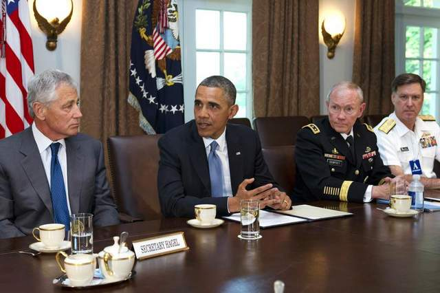 Defense Secretary Chuck Hagel, President Obama, Joint Chiefs Chairman Gen. Martin Dempsey, and Vice Chief of Naval Operations Adm. Mark Ferguson Jacquelyn Martin AP