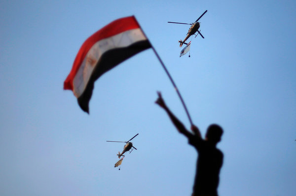 Egypt militar helicopters and boy with flag