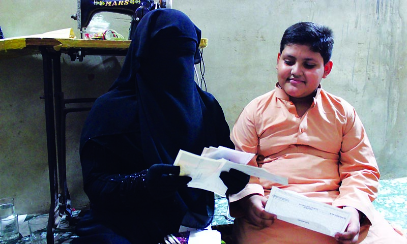 Guantanamo widow, Ahmed Rabbani's wife, 25-year-old Fawzia and their 11-year-old son, Jawad, look at his letters.