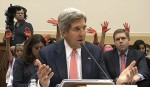 John Kerry urges war, people with blood on their hands raised behind him