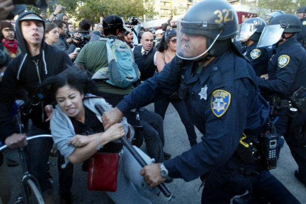 Occupy Oakland Police use gas, flashbangs, clubs and fists