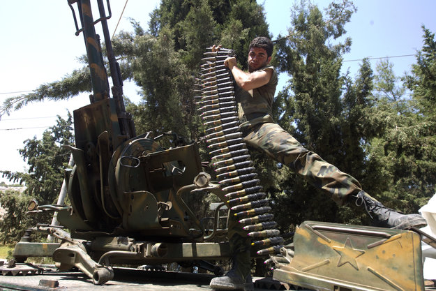A Syrian rebel fighter loads an anti-air