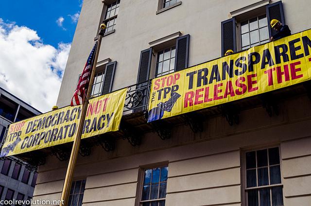 TPP USTR Ann Meador Two Signs