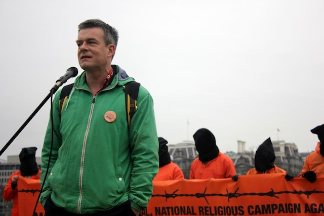 Andy Worthington with protesters behind him