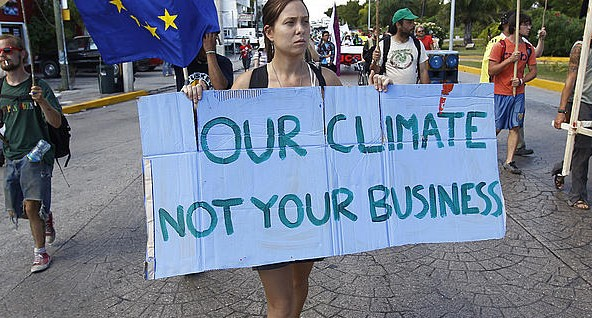 Climate and business protest sign