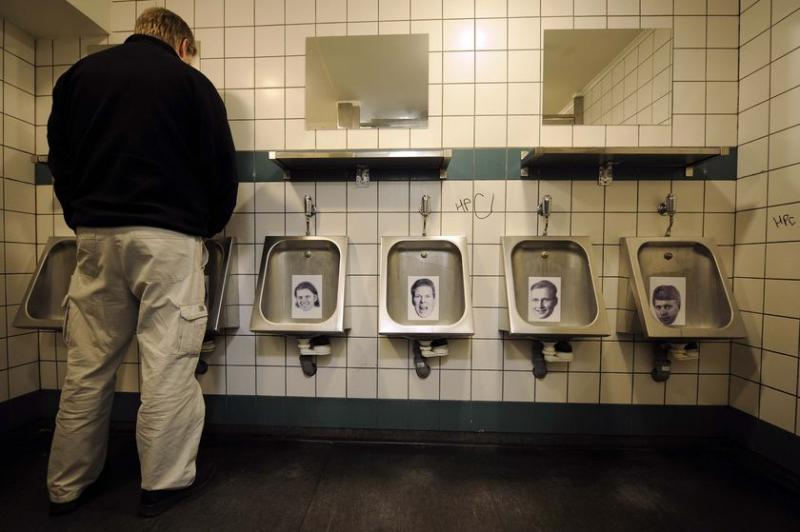 Iceland bankers, photos of former Icelandic bankers who left their country after the financial crash were stuck on the urinals. (AFP Olivier Morin, file photo)