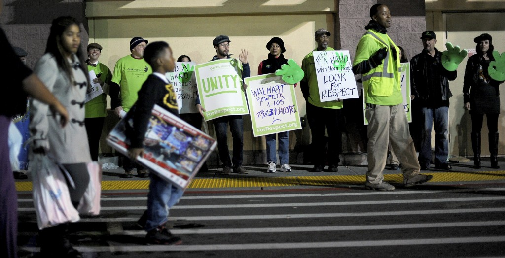 Protesters picket outside a Walmart store as holiday sales commence in San Leandro