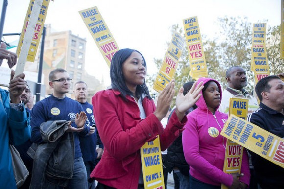 Tayzia Treadwell claps after a speech during the raise the minimum wage rally held on Oct. 22, 2013 in Journal Square in Jersey City. More than 150 elected officials, residents and representatives of unions and Working Families of New Jersey came together to rally for raising the state minimum wage by $1 to $8.25 via the referendum to be voted on in the November election. Alyssa Ki/The Jersey Journal
