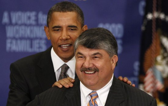 U.S. President Obama stands behind AFL-CIO President Trumka before he speaks at the AFL-CIO Executive Council meeting in Washington