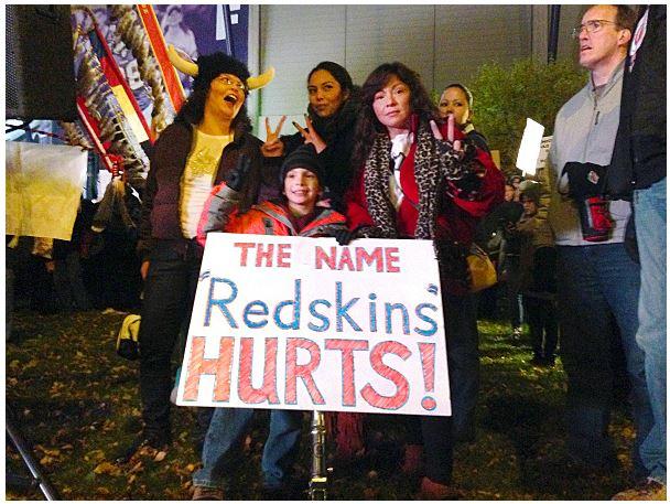 Roman Vizenor, 7, at center, protests the Washington Redskins' nickname. (MPR photo/Jon Collins)