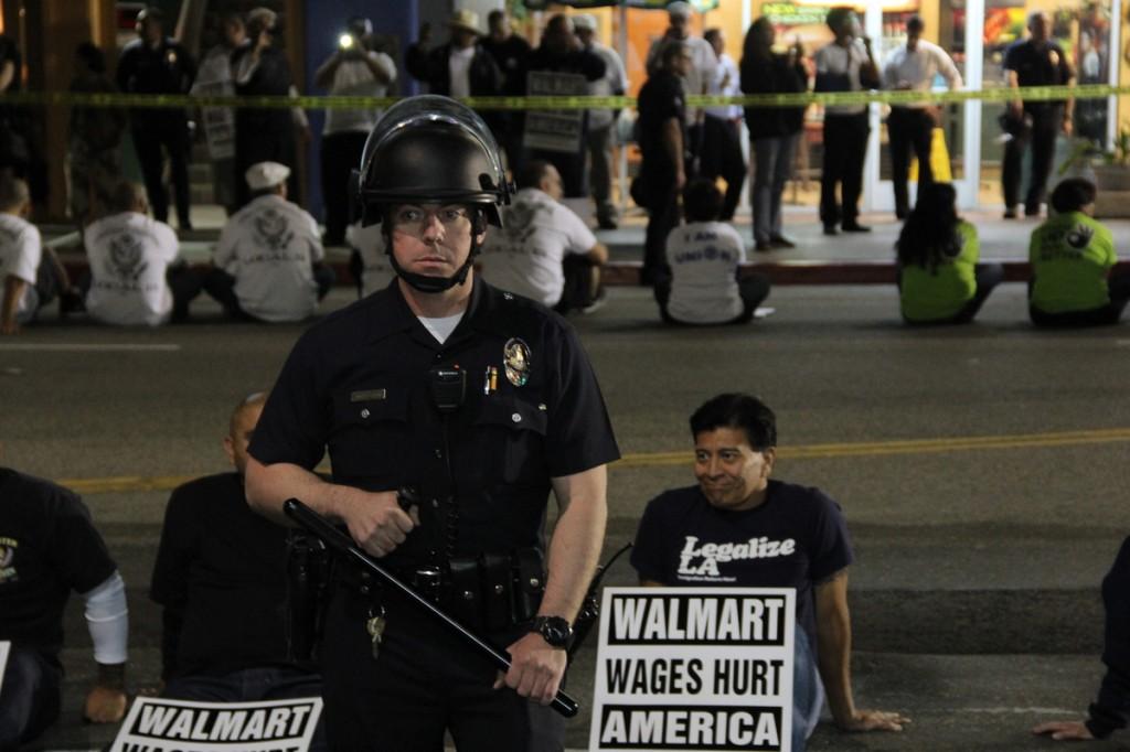 Walmart workers LA block street with police