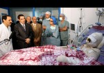 Former-Tunisian-President-Zine-El-Abidine-Ben-Ali-visits-Mohamed-Al-Bouazzizi-right-at-the-hospital-in-Ben-Arous-near-Tunis-on-December-28-2010.-Source-Handout-from-Tunisian-Presidency-of-Zine-El-Abidine-Ben-Ali.