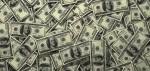 Money piles of 100s