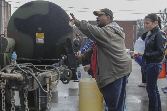 WV water from a tanker truck Local residents pick up drinking water from a tanker truck at West Virginia State University in Charleston, West Virginia January 10.