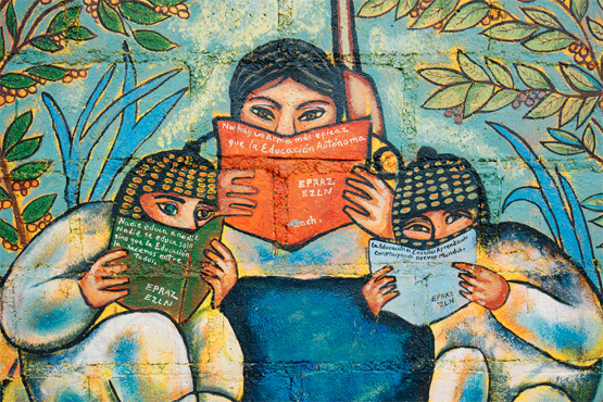 A Zapatista mural in the town of San Pedro Polhó illustrates ideas about education. Photo by Dario Ribelo on Flickr