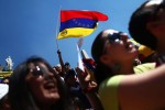 Venezuelan opposition supporter waves a Venezuelan flag during a protest against Venezuelan President Nicolas Maduro's government at Angel de la Independencia monument in Mexico City, February 16, 2014.(Reuters / Edgard Garrido )