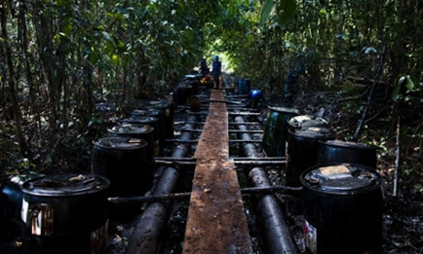Workers from Argentine firm Pluspetrol clean up after an oil spill in the Amazon region of Loreto