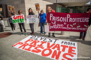 Immigrant rights activists protested the Gates Foundation for their support of notorious private prison company GEO Group. (Photo: Alex Garland via Presente.org)