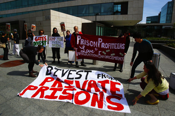 Protesters outside of Gates Foundation urging divestment from private prisons, from Seattle Times
