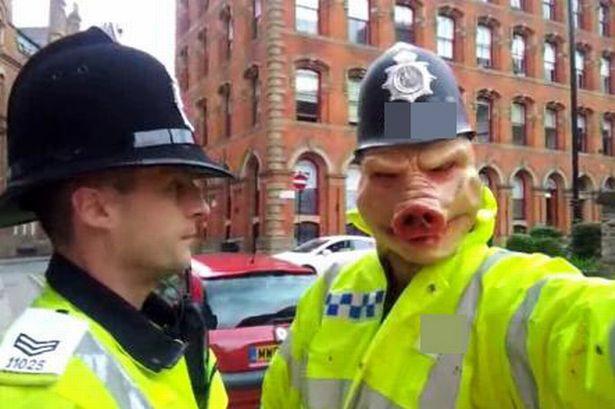 Police pig dressed as police arrested for impersonating an officer