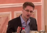 Snowden talking at table in Russia