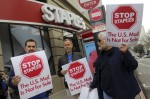U.S. Postal Service employees carry signs during a demonstration with colleagues in San Francisco