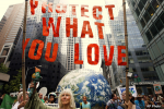 Demonstrators make their way down Sixth Avenue in New York during the People's Climate March Sunday, Sept. 21, 2014.S