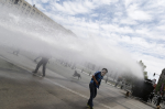 A Mapuche Indian activists dodges a jet of water during a protest against Columbus Day in Santiago October 12, 2014. This year marks the 522th anniversary of Christopher Columbus' arrival to the Americas. — Reuters pic - See more at: http://www.themalaymailonline.com/world/article/mapuche-indian-protestors-in-tears-for-condemning-columbus-day-in-chile#sthash.qJRoPYik.dpuf
