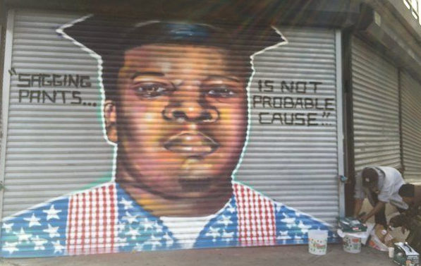 A mural depicting Ferguson teen Michael Brown, who was shot and killed by police earlier this year, was removed from a gate on the corner of North Broad and Hanover Streets on Monday Oct. 20, 2014 after concerns from police. (Jenna Pizzi / Times of Trenton)