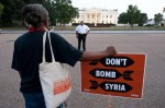 An anti-war demonstrator is seen outside the White House before President Photo By Nicholas Kamm / AFP/Getty