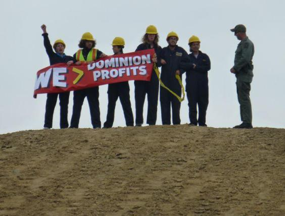 Cove Point protesters holding banner By Kevin W. Thomas