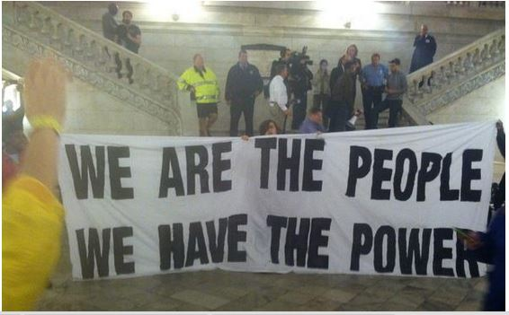 People have the power; protest in Ferguson City Hall in 2014.