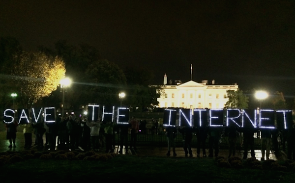 "Protestors organized a ""light brigade"" outside the White House on Thursday night to promote net neutrality. (Photo by Nancy Scola/The Washington Post)"
