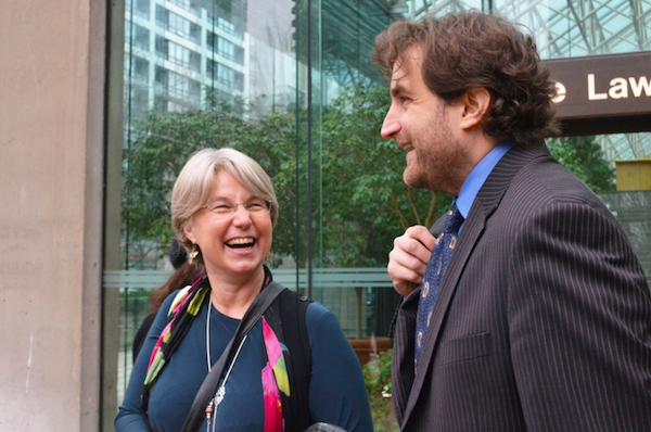 SFU professor Lynne Quarmby with her lawyer Jason Gratl celebrating a ruling, outside the B.C. Supreme Court on Thursday. Photo by Jenny Uechi.