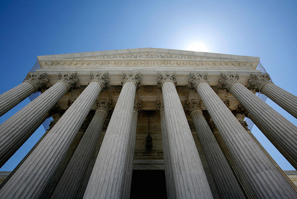 PILLARS OF JUSTICE: Although the U.S. Supreme Court is the most diverse it has ever been – three of the nine justices are women and two are minorities – the elite bar that comes before it is strikingly homogeneous: Of the 66 top lawyers, 63 are white. Only eight are women. REUTERS/Molly Riley
