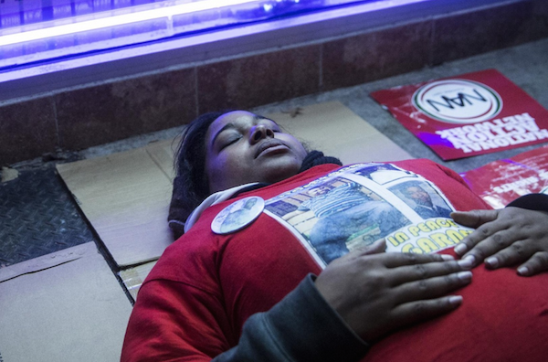 Erica Garner, the daughter of Eric Garner, during a die-in on the spot where her father died. Photograph: Andrew Burton/Getty Images