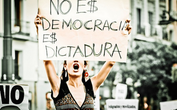 "Sign: ""This is not democracy, it is a dictatorship"" - Protest in Madrid, Spain. (Photo: Marta Breijo / Flickr)"