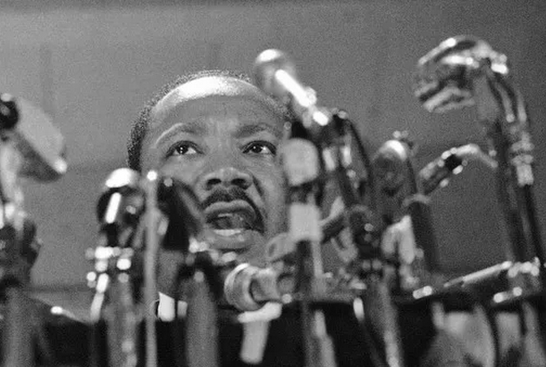 In Chicago in 1967, Martin Luther King delivers a speech calling for an end to fighting in Vietnam. (AP Photo/Charles Harrity)