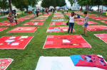 Crowd-sourced quilts with messages about domestic violence or sexual assault were laid out on a lawn in Baltimore in August 2014. (Monument Quilt)