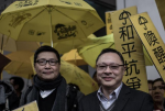 Leading pro-democracy activists, (L-R) Chan Kin-man, Benny Tai and Chu Yiu-ming outside the Wanchai police station in Hong Kong on January 24, 2015 (AFP Photo/Philippe Lopez)