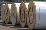 Giant rolls holding fiber optic cable are stored, waiting to be installed as a part of a broadband project in northern Minnesota, July 31, 2012. BRUCE BISPING — MCT  Read more here: http://www.mcclatchydc.com/2014/03/05/220125/fcc-questions-state-laws-that.html#storylink=cpy