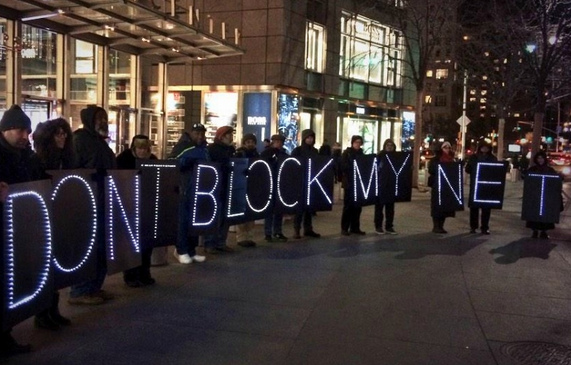 Protesters rally outside of Time Warner Cable Headquarters in New York Monday, February 23. (Photo courtesy of Media Action Grassroots Network)