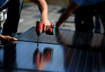 SolarCraft workers install solar panels on the roof of a home in San Rafael, Calif. According to a report by the Solar Foundation, the solar industry employs more workers than the coal-mining industry. (Justin Sullivan/Getty Images)