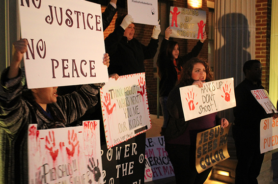 Community members and organizers with the Next Generation Action Network protest outside Grapevine, Texas, City Hall March 10, 2015. The group is calling for Grapevine police officials to release the dash-cam video of Officer Robert Clark's fatal shooting of Rubén García Villalpando. (Photo: Candice Bernd)