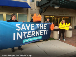 Net neutrality advocates holding sign at the Occupation of the FCC. By John Zangas, DC Media Group.
