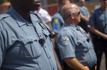 Members of the Ferguson Police Department wear body cameras during a rally on Aug. 30, 2014, in Ferguson, Missouri. Police in Ferguson were outfitted with cameras as a reaction to protests over the shooting death of Michael Brown, an 18-year-old unarmed teenager. (Photo by Aaron P. Bernstein/Getty Images)