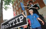 12/07/2014 - Protests against the EU-US trade deal (TTIP - Transatlantic Trade and Investment Partnership) outside Europe House, the London Headquarters of the European Commission and the European Parliament, in Smith Square, London. A puppeteer on stilts with a 'puppet' dressed as an NHS nurse to highlight the threat the deal poses to public services like the NHS. This picture can be used free of charge.